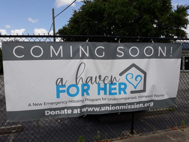 A banner on Fahm Street broadcasts Union Mission's new housing program for unaccompanied homeless women. It is expected to open in January 2022.