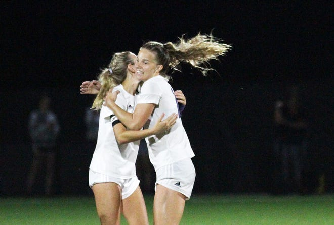 Three Rivers' Alivia Knapp celebrates with Olivia Penny after the Lady Wildcats secured a 6-1 victory over Comstock in the regional semifinals on Tuesday.