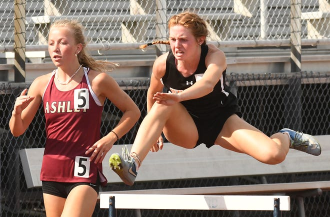New Hanover's Meagan Lundin jumps a barrier on her way to a win the girls 300-meter hurdles Wednesday at the Mideastern Conference track & field championships. The freshman won all four individual events she entered.