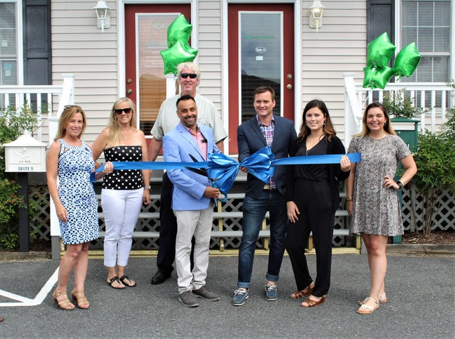 The Rehoboth Beach-Dewey Beach Chamber of Commerce and member Matthew Trone celebrated the grand opening of FitzGerald Financial Rehoboth Beach with a ribbon-cutting ceremony. From left: Candace Hall, Pam FitzGerald, Dan FitzGerald, Matthew Trone, James Anecharicho, Kristen Hall, Abigail Kaiser, RBDB Chamber.