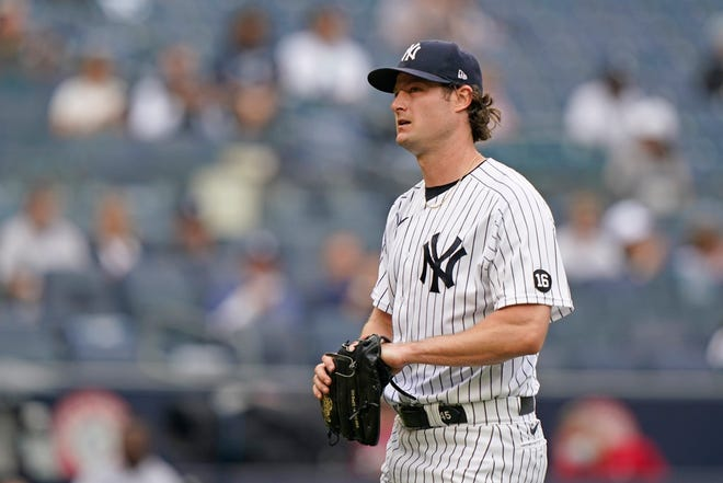 New York Yankees starting pitcher Gerrit Cole (45) reacts heading to the dugout after allowing a two-run home run to Tampa Bay Rays designated hitter Austin Meadows last week at Yankee Stadium in New York.