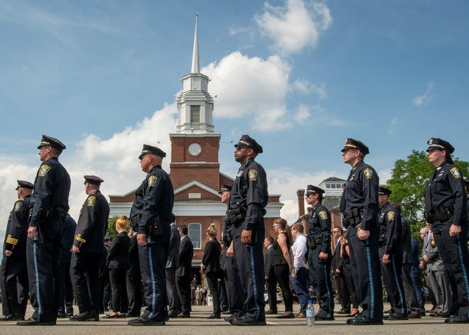 """Members of the Boston Police Department and others line up outside St. John Church in Worcester to pay their respects to Worcester Police Officer Enmanuel """"Manny"""" Familia on June 9."""