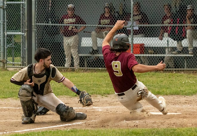 WORCESTER - Shepherd Hill's Connor Johnston scores past the tag attempt from Doherty catcher Jacob Acevedo Tuesday, June 8, 2021.