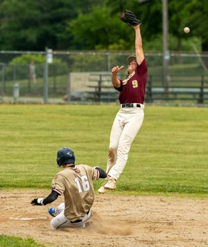 Doherty's Cam Early steals second base as the throw sails over Shepherd Hill's Connor Johnston.