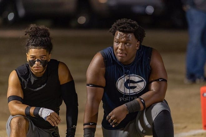Five-star 2022 Grimsley defensive tackle Travis Shaw (right) helped the Whirlies win the NCHSAA 4-A state championship in May. The 6-foot-5, 310-pound Shaw ranks as the No. 1 rising senior in the state and No. 9 overall recruit in his class, per 247Sports and published by The Fayetteville Observer.