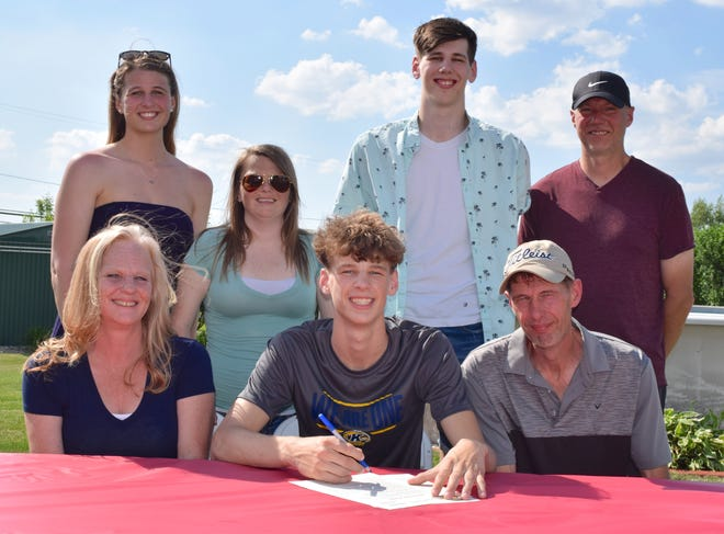 Signing a letter of intent is Kyle Shockley (seated center) sitting between his mother Robin(left) and his father Harold. In the back row are Shockley's sisters Kaylee and Krista, his brother Kameron and Jason Wise, Waterloo Head Basketball Coach.