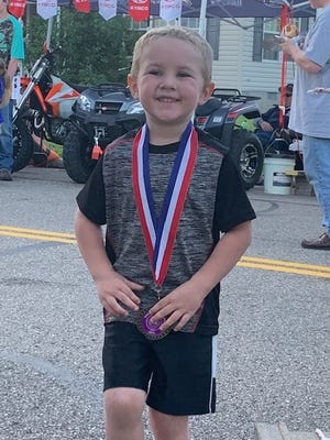 Weston Krocker, then 4, shows off his medal from running 1 mile race at Tusky Days Festival in 2019.
