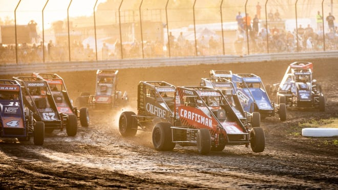 A pack of USAC Midget cars careen into the fourth corner at Gas City I-69 Speedway. The track hosts the next-to-last leg of Indiana Midget Week Friday night.