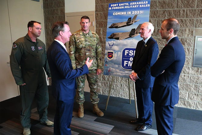 Fort Smith Regional Chamber of Commerce President & CEO Tim Allen, center left, talks with Arkansas Gov. Asa Hutchinson and Mike Preston, Arkansas Department of Commerce secretary, and members of the 188th Wing in Fort Smith during the Mid-America Aerospace & Defense Summit, Wednesday, June 9, at the Fort Smith Convention Center.