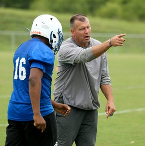 New Tuscaloosa County High football coach Adam Winegarden puts his team through a workout Tuesday, June 8, 2021. Winegarden most recently coached at Auburn High School. [Staff Photo/Gary Cosby Jr.]