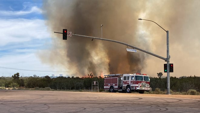 A vegetation fire burns west of Interstate 15 in the area of Hesperia and Oak Hills on Wednesday, June 9, 2021.