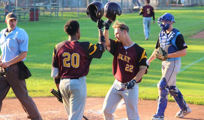 Heat's Mathew Marlow hits a solo home run in the bottom of the second and is greeted by Justin Johnson at home plate.
