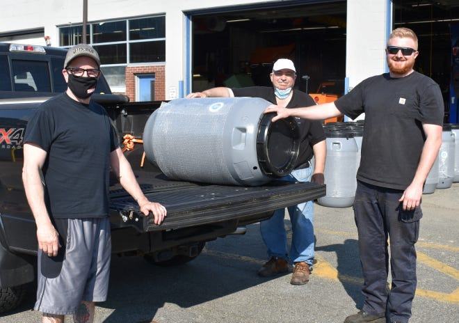 The Wakefield Department of Public Works has sold more than 800 rain barrels at a discounted price since 2018 through its partnership with Great American Rain Barrel Company. DPW staff Gus Graffeo, center, and Terin O'Neil, right, helped to distribute 121 rain barrels to residents including James Sciarappa, left, during the most recent distribution at the DPW's North Avenue garage.