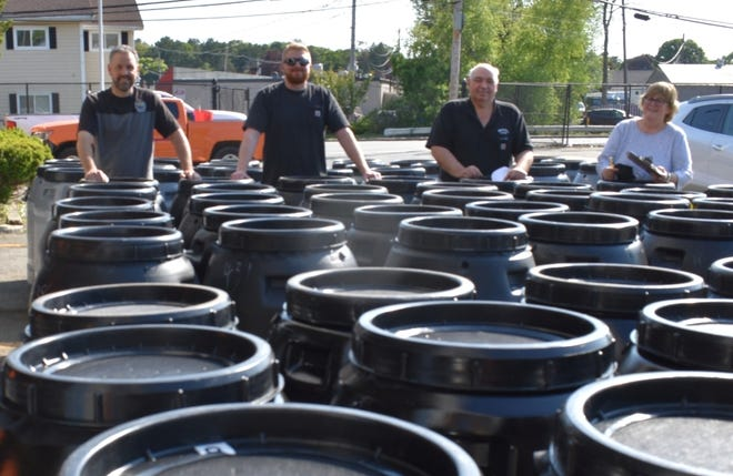 The Wakefield Department of Public Works staff, pictured, from left: Dan Pascucci, Terin O'Neil, Gus Graffeo and Business Manager Ann Waitt recently distributed 121 rain barrels to Wakefield residents who purchased them at a discounted price through the department's partnership with the Great American Rain Barrel Company.