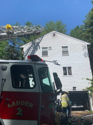 Firefighters respond to 272 York St., Canton, to battle a basement fire Wednesday, June 9.