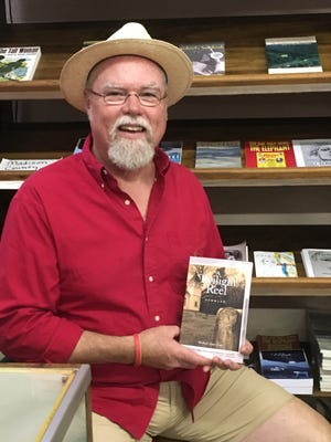 """Madison County native Michael Amos Cody's new book of short stories, """"A Twilight Reel,"""" has received comparisons to the work of James Joyce. Cody is pictured here at Penland & Son's Department Store in Marshall."""