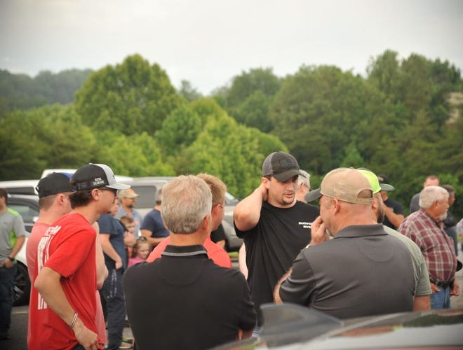 A rally in support of local law enforcement took place prior to the Madison County Board of Commissioners' meeting in the parking lot of the N.C. Cooperative Extension June 8.