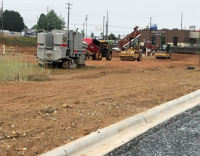 A new Chick-fil-A restaurant, a convenience store, and an automotive retail store will go on this parcel on Airport Road in Arden, near Walmart and Carolina Furniture Concepts.