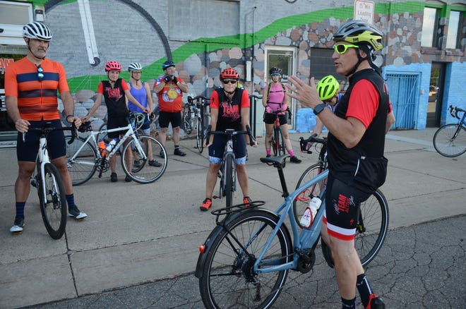 Mike Wood speaks to riders about the 2026 Kalamazoo bicycle crash before a group ride in Battle Creek on Tuesday.