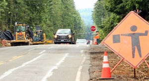 Local traffic moves through the construction zone on Seabeck Highway on Wednesday.