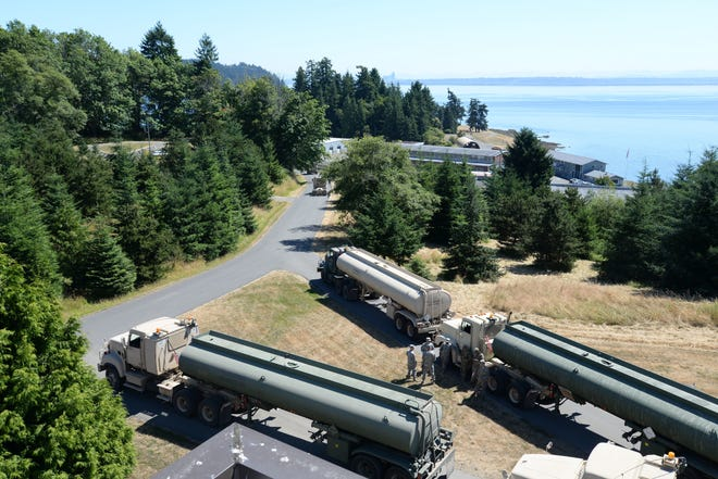 A convoy of fuel trucks from the 475th Quartermaster Group prepare to depart Manchester Fuel Depot to deliver a load of aviation fuel to Joint Base Lewis-McChord during the 2017 Quartermaster Liquid Logistics Exercise (QLLEX).