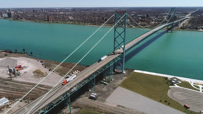 Travel is still restricted between the United States and Canada but that may be changing soon. A drone photo shows the Ambassador Bridge, that connects the U.S. to Canada is virtually empty except for trucking traffic on April 2, 2020.