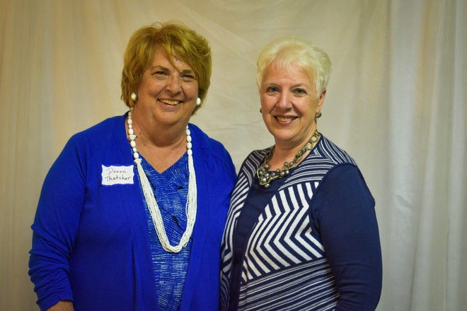 Fremont Area Women's Connection Area Representative Donna Thatcher, left, stands with Janis Price who traveled from her home in Greencastle, Indiana to be the special speaker during the group's June 8 luncheon.