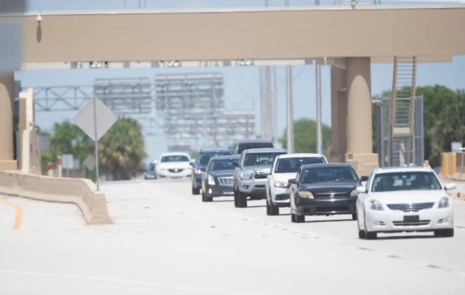 Traffic streams through the midpoint bridge toll booth on Wednesday, June 9, 2021. As of Oct. 1, motorists who do not use a transponder ot cross the bridge will face a $3 penalty. Lee County will make all-electronic toll collection permanen