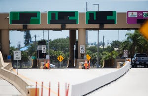 The Midpoint Memorial Bridge brige toll booth on Wednesday, June 9, 2021. Lee County will make all-electronic toll collection permanent.