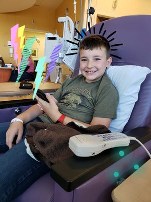 Ethan Stiller, 13, receives intravenous medication to treat his Crohn's disease symptoms.