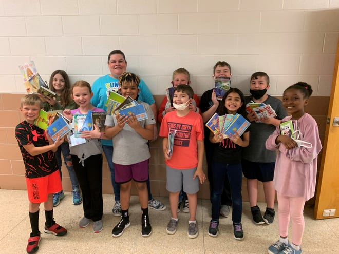 From left to right: Turner Wilson, Alyssa Thompson, Kaymen Davis, Alan Bautista, Mia Segovia, Arabia Brown, Kennedy Irwin, Alicia Davis, Andrew Strack, Garrett Wright and Mustafa Maras. Kids in second and third grade at Pleasant Elementary School received five books to read over the summer break due to a $2,000 grant from the Marion Community Foundation.