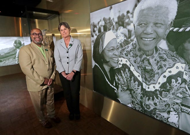 Ellen Censky and Robert Davis, presidents of the Milwaukee Public Museum and America's Black Holocaust Museum, at the Milwaukee Public Museum's Nelson Mandela exhibit in Milwaukee on Wednesday, June 9, 2021. The two museums have partnered to bring the Nelson Mandela exhibit to Milwaukee.