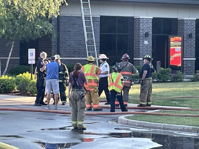 Firefighters work at the scene of a small fire inside a medical building on Division Road on Tuesday evening.