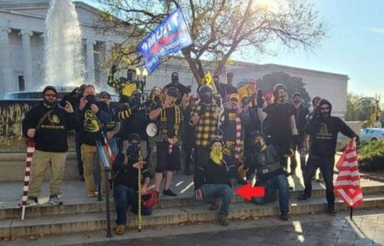 """Authorities say Shawn Price attended a """"MAGA March"""" with fellow Proud Boys members in Nov. 14, 2020 in Washington, D.C. Price is identified with a red arrow."""