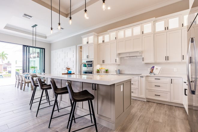 Luxury kitchen design includes state-of-the-art appliances, proper lighting and functional style.