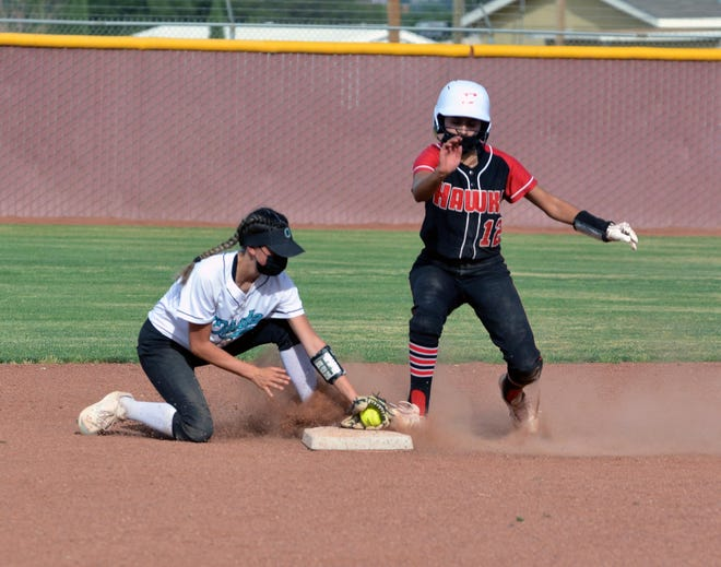 Oñate's Madison Chavez (left) tags Centennial's  Gianna Villagas (right) a little too late at second base during the first game of a doubleheader.