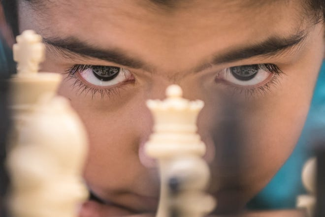 Manuel Castillo Jr., New Mexico's elementary school chess champion, plays chess with Sun-News writer Algernon D'Ammassa at the Sun-News newsroom on Wednesday, June 9, 2021.