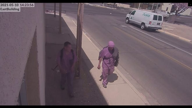 Brian Benally, left, walks with an unidentified man in video surveillance footage from May 10 from a Farmington Police Department produced video released on June 9. Law enforcement released a video depicting the alleged events where Benally allegedly fired a gun more than 24 times in downtown Farmington, before he was shot by police in the 100 block of West Animas Street.