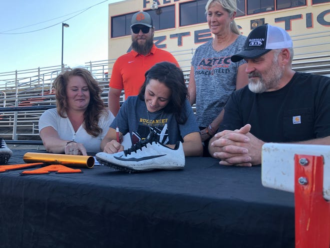Aztec's Helen Moore signs her national letter of intent on Tuesday, June 8, 2021, to continue her track and field career at NAIA's Park University.