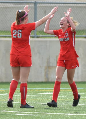 Canton Chief Morgan Kroon, right, celebrates her goal, Canton's first of the night, with teammate Emily Woods.