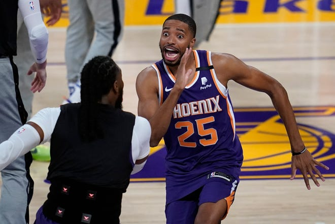 Phoenix Suns forward Mikal Bridges (25) is introduced before Game 6 of an NBA basketball first-round playoff series against the Los Angeles Lakers Thursday, Jun 3, 2021, in Los Angeles. (AP Photo/Ashley Landis).