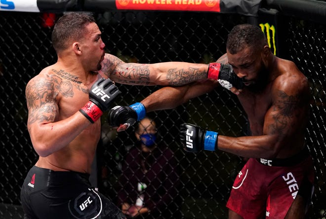 LAS VEGAS, NEVADA - MARCH 13: (L-R) Eryk Anders punches Darren Stewart of England in a middleweight fight during the UFC Fight Night event at UFC APEX on March 13, 2021 in Las Vegas, Nevada. (Photo by Jeff Bottari/Zuffa LLC via Getty Images)