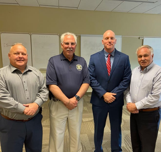 Newly appointed York County Prison warden Adam Ogle poses with members of the Prison Board of Inspectors. From left: Commissioner Ron Smith, York County Sheriff Rich Keuerleber, Ogle and Board president Doug Hoke.