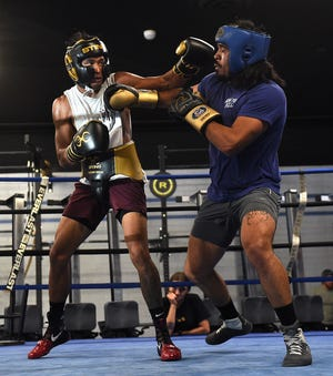 Local boxer JJ Mariano, left, spars with Pablo Gomez at Elite Boxing & Crossfit in Reno on June 8, 2021.