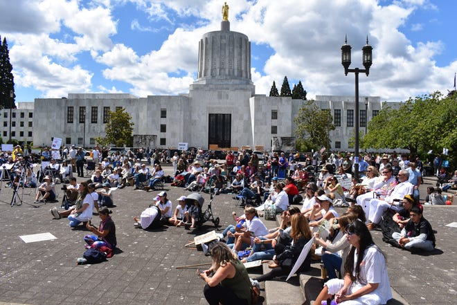 About 200 people gathered for the Oregonians for Medical Freedom Vigil to stand against vaccine passports at the Oregon State Capitol on Wednesday, June 9, 2021.