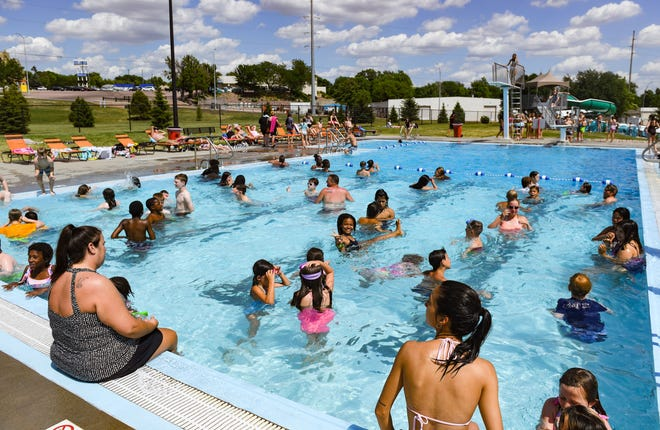 Kids cool off in the water on Wednesday, June 9, 2021, at the Drake Springs Family Aquatic Center in Sioux Falls.