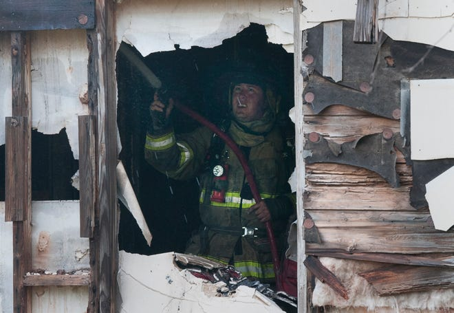 Wichita Falls firefighters worked to control a house fire Tuesday morning on 32nd Street.