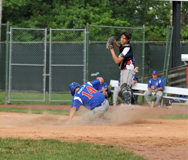 Cambridge Legion's Blade Barclay slides into home after a hit during a game with Zanesville on Wednesday at Gant.