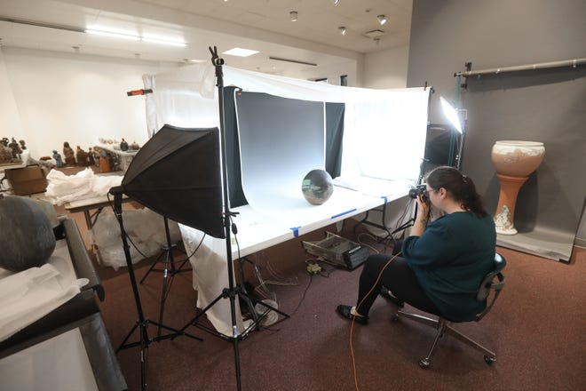 Kathryne Applegate, Zanesville Museum of Art's collection coordinator, photographs a piece as part of the ZMA's ongoing digitization process.