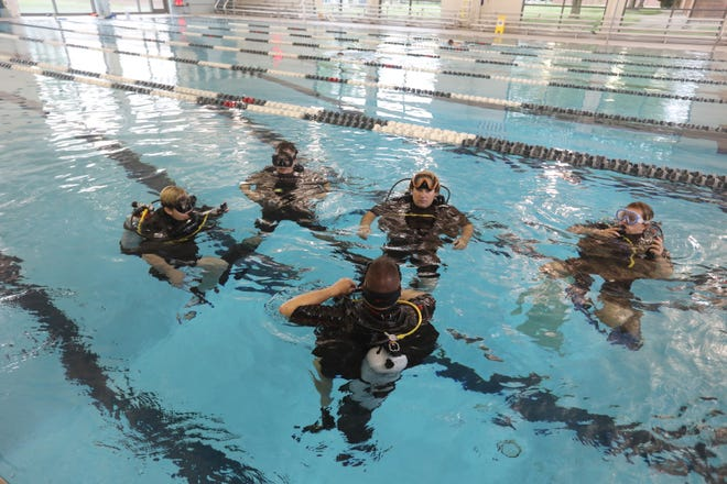 Jim Gallas, of Pneuma Scuba Diving, teaches a class in the YMCA pool in Zanesville recently.